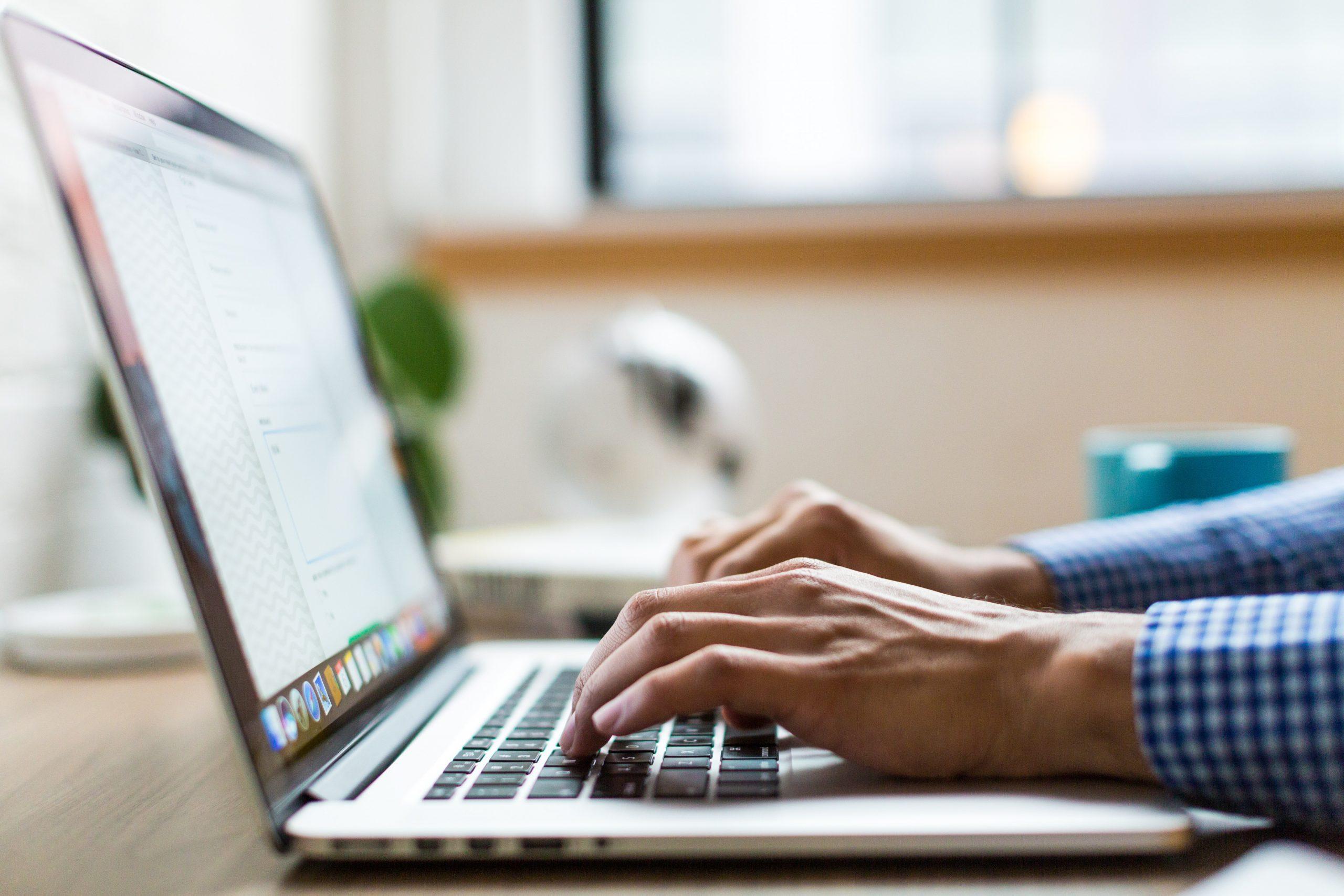 hands working on computer
